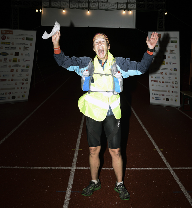 This is the face of one very happy finisher. Vero finding out she has achieved third woman overall in the Berlin 100.